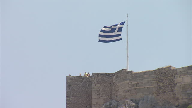 exterior shots of tourists visiting ancient ruins and a greek flag on top of a castle on july 10 2015 near athens greece - greek flag stock videos & royalty-free footage