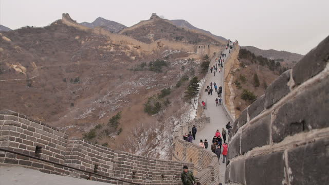 exterior shots of tourists walking along the badaling section of the great wall of china scenic shots of the great wall of china on december 06 2012... - badaling great wall stock videos & royalty-free footage