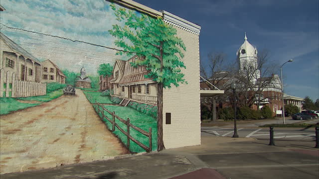 Exterior shots of town signage and a mural celebrating Harper Lee's To Kill a Mockingbird in Monroeville Alabama on February 18 2015 in Monroeville...