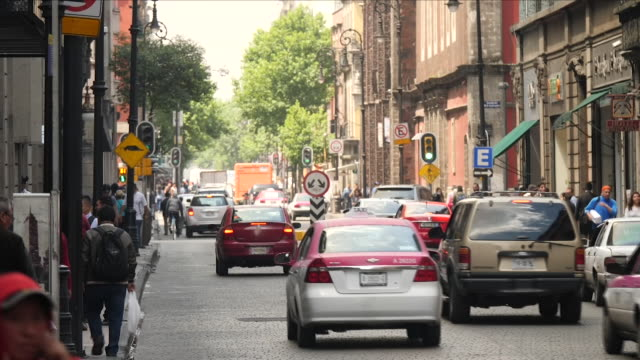 exterior shots of traffic and pedestrians crossing the road in a busy shopping area as police direct traffic on 28 june 2018 in mexico city mexico - mexico city stock videos & royalty-free footage