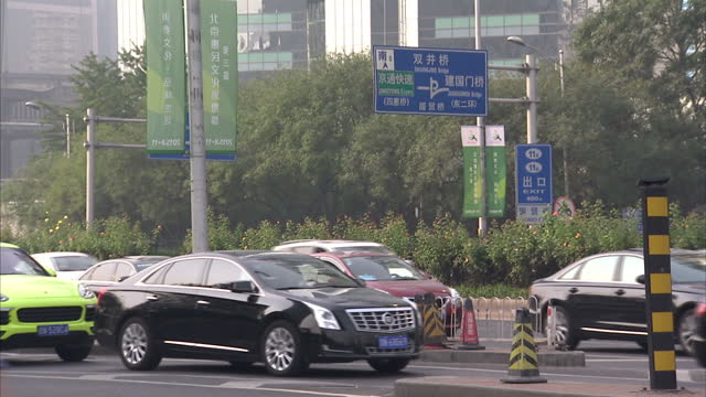 Exterior shots of traffic and skyscrapers in Beijing including shots of CCTV Headquarters nicknamed Big Shorts>> on September 20 2015 in Beijing China
