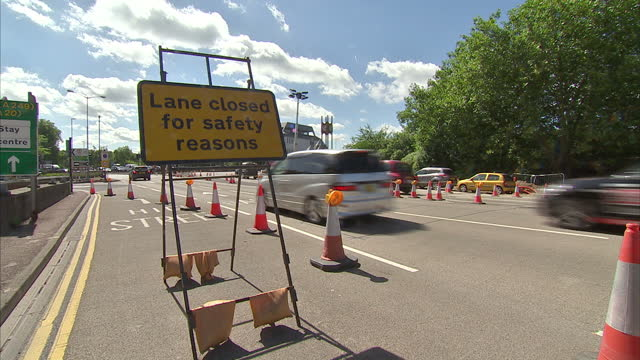 exterior shots of traffic driving past roadworks complete with cones and signs warning of lane closures on a sunny day on august 13 2016 in maidstone... - maidstone stock videos and b-roll footage