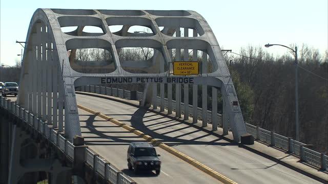 Exterior shots of traffic driving through Selma and crossing the Edmund Pettus Bridge>> on March 07 2015 in Selma Alabama