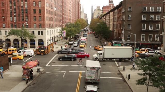 exterior shots of traffic on 10th avenue in the chelsea district of manhattan, new york on september 27th, 2015 shots overhead wide shot from the... - chelsea new york stock videos & royalty-free footage