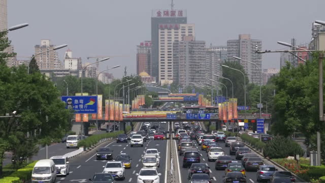 stockvideo's en b-roll-footage met exterior shots of traffic on a beijing highway with banners advertising the 'belt and road' trade scheme on 14 may 2017 in beijing china - politics and government