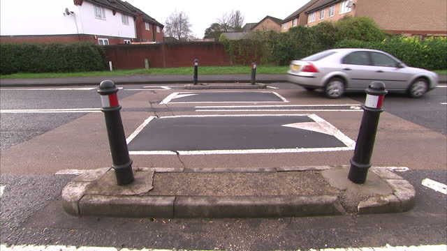exterior shots of traffic speed calming measures including speed bumps and a kerb extension traffic speed calming measures on january 10 2014 in... - kerb stock videos and b-roll footage