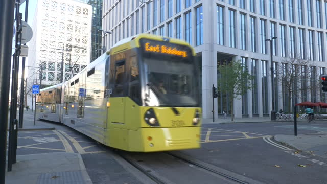 exterior shots of trams passing manchester central library and an empty st peter's square during coronavirus lockdown on 12th november 2020 london,... - tram stock videos & royalty-free footage