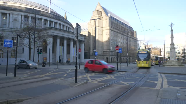 exterior shots of trams passing manchester central library and an empty st peter's square during coronavirus lockdown on 12th november 2020 london,... - state of the vatican city stock videos & royalty-free footage