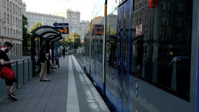 exterior shots of trams stopping at tram stops in the centre of leipzig as commuters embark and disembark on 30 november 2017 in leipzig germany - tram stock videos & royalty-free footage