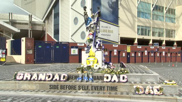 exterior shots of tributes paid to jack charlton on the billy bremner statue outside elland road - jack charlton stock videos & royalty-free footage