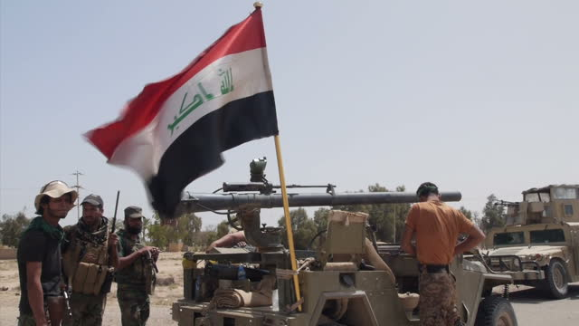 Exterior shots of troops from the Iraqi military preparing vehicles march through town in formation looking for Islamic State fighters on April 20...