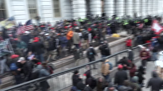 exterior shots of trump supporters breaking into the north side of the united states capitol building senate's wing, on 6 january 2021 in washington... - アメリカ国会議事堂点の映像素材/bロール