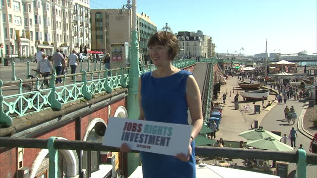 Exterior shots of TUC General Secretary Frances O'Grady posing for a photocall on Brighton seafront holding a 'Jobs Rights Investment' sign on...
