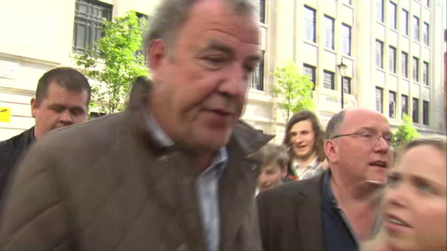 exterior shots of tv presenter jeremy clarkson exiting bbc broadcasting house and make way through media scrum ignoring questions from journalists on... - jeremy clarkson stock-videos und b-roll-filmmaterial