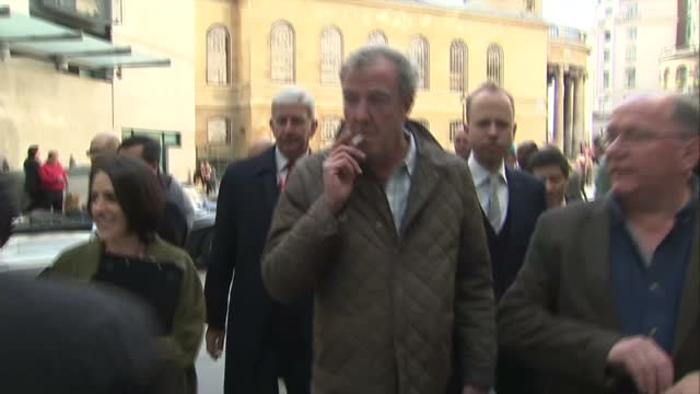 exterior shots of tv presenter jeremy clarkson walking to bbc broadcasting house talking to people as he walks past media scrum at on may 21 2015 in... - jeremy clarkson stock-videos und b-roll-filmmaterial