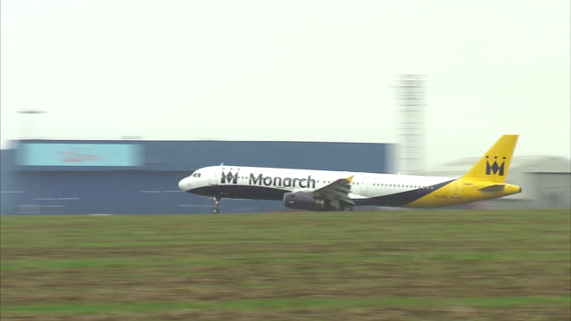 exterior shots of two monarch airlines planes taking off at luton airport on october 01, 2017 in luton, england. - luton airport stock videos & royalty-free footage