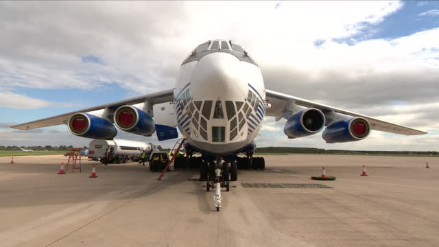 exterior shots of uk aid bound for victims of the indonesian earthquake on pallets being loaded by fork lift truck onto a large transport plane on 5... - indonesia earthquake stock videos & royalty-free footage