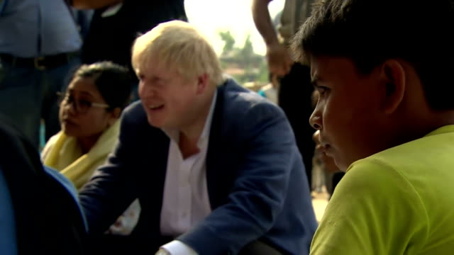exterior shots of uk foreign secretary boris johnson speaking to rohingya women and children at a refugee camp on february 10 2018 in cox's bazaar... - cox's bazaar stock videos and b-roll footage