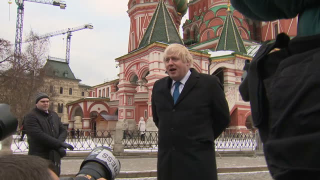 exterior shots of uk foreign secretary boris johnson visiting red square posing briefly for members of the media in front of st basil's cathedral and... - hold me tight stock videos & royalty-free footage