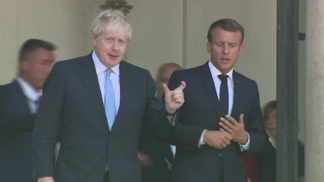 exterior shots of u.k. prime minister boris johnson leaving elysee presidential palace after meeting french president emmanuel macron elysee... - prime minister stock-videos und b-roll-filmmaterial