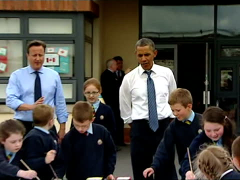 Exterior shots of UK Prime Minister David Cameron US President Barack Obama painting large school painting with the school children from Enniskillen...
