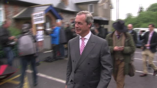 exterior shots of ukip leader nigel farage posing for photocalls outside his polling station in biggin hill on june 23, 2016 in biggin hill, england. - biggin hill stock videos & royalty-free footage