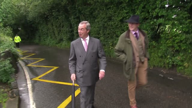 exterior shots of ukip leader nigel farage wlk to polling station in biggin hill smiling, jokes that he's 'thinking about' which way to vote on june... - biggin hill stock videos & royalty-free footage