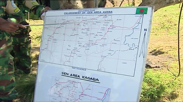 exterior shots of un and bangladeshi military troops patrolling a rural area and sit in a briefing on march 20 2006 in democratic republic of congo - bürgerkrieg stock-videos und b-roll-filmmaterial