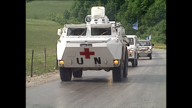 exterior shots of un protection force troops standing on armoured vehicle; exterior shots of sarajevo airport; exterior shots of un convoy arriving... - bosnian war stock videos & royalty-free footage