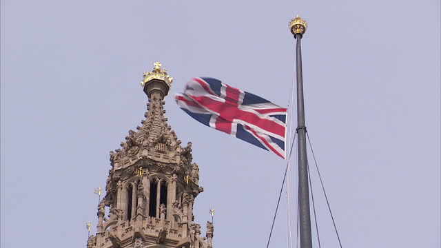 exterior shots of union flag flying at half mast over victoria tower, houses of parliament flag at half mast over victoria tower on april 08, 2013 in... - union jack stock videos & royalty-free footage