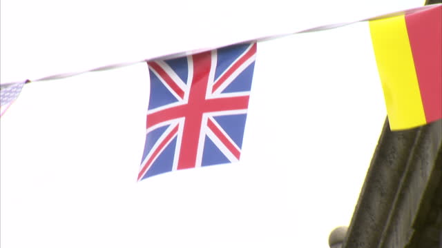 exterior shots of union street, the main shopping area in aberdeen city centre & flags on bunting including the union jack, saltire & st george's... - 2014 stock videos & royalty-free footage