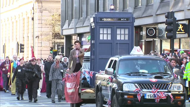 exterior shots of unofficial dr who float on new year's day parade with fans dressed up in doctor who costumes including lookalikes of david tennant,... - doctor who stock videos & royalty-free footage