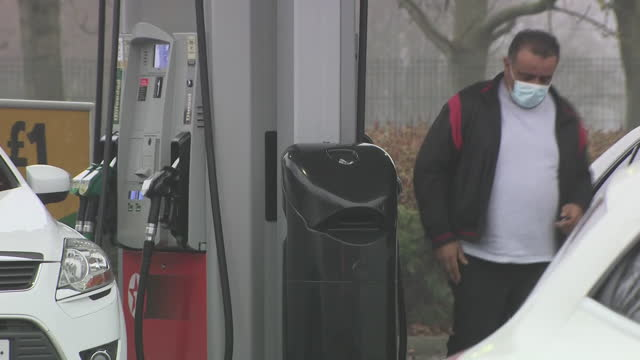 exterior shots of urban homes and motorists filling up at a petrol station in wolverhampton on 3rd march 2021.united kingdom - city life stock videos & royalty-free footage