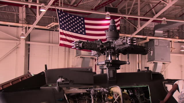 exterior shots of us apache military attack helicopters in a hangar with missiles being prepared during joint us south korean military exercises on 8... - 演習点の映像素材/bロール