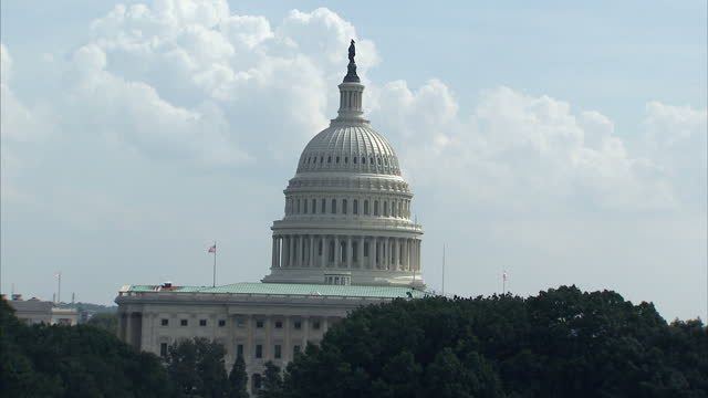 Exterior shots of US Capitol building pan across dome on roof of building and zoom in on it United States Capitol building on summers day on August...