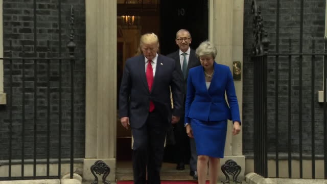exterior shots of us president donald trump and prime minister theresa may walking to the foreign and commonwealth office for a press conference on... - state visit stock videos & royalty-free footage