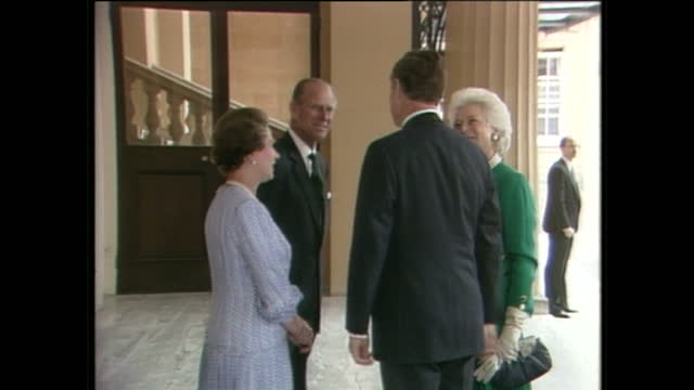 Exterior shots of US President George H W Bush and Barbara Bush arriving and being greeted by Queen Elizabeth II and Prince Philip Duke of Edinburgh...