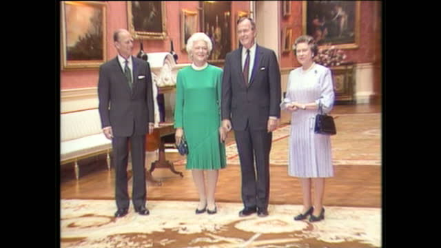 Exterior shots of US President George H W Bush and Barbara Bush walking with Queen Elizabeth II and Prince Philip Duke of Edinburgh at Buckingham...