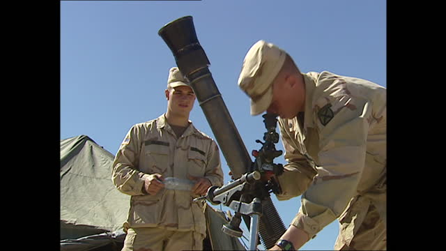 exterior shots of us troops practice setting up weapon on 26th march 2002 in bagram airfield, afghanistan. - bagram stock videos & royalty-free footage