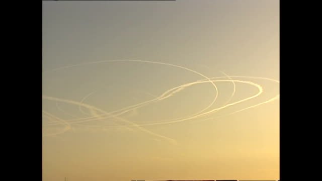 exterior shots of vapour trails in the sky in afghanistan from us warplanes on october 29, 2001 in kabul, afghanistan. - bomber stock videos & royalty-free footage