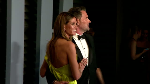 Exterior shots of various actors and celebrities on the red carpet at the Vanity Fair Oscars Afterparty including Faye Dunaway Heidi Klum Taylor Hill...