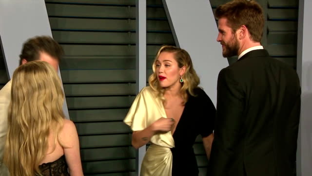 Exterior shots of various celebrities on the red carpet at the Vanity Fair Oscars Afterparty including shots of Miley Cyrus and Liam Hemsworth Sarah...