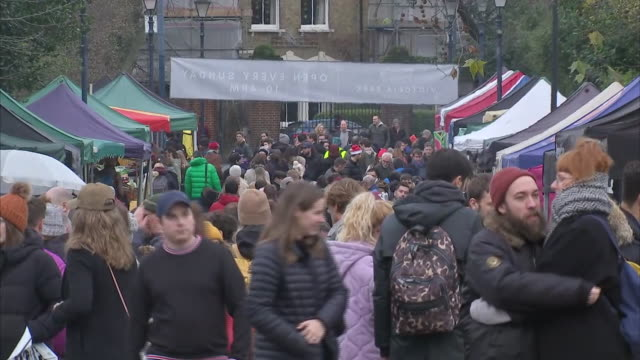 exterior shots of various food stalls at victoria park market with people sampling varoius different types of street food on offer on 21 december... - victoria park london stock videos & royalty-free footage