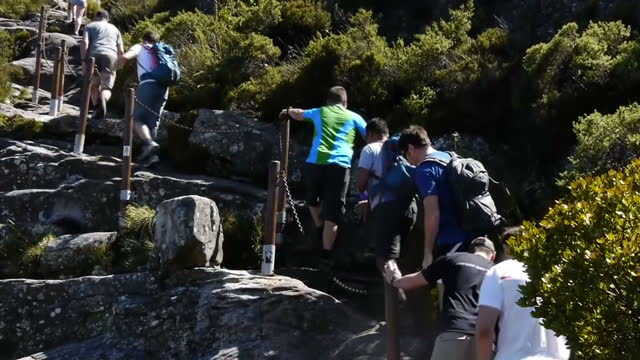 vídeos de stock, filmes e b-roll de exterior shots of various members of the walking with the wounded south pole allied challenge teams climbing table mountain walking with the wounded... - península