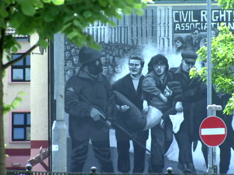 exterior shots of various murals depicting the troubles and the bloody sunday massacre - sonntag stock-videos und b-roll-filmmaterial