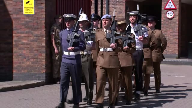 Exterior shots of various regiments of the Household Cavalry marching from their barracks as part of the Prince Harry / Meghan Markle wedding day...
