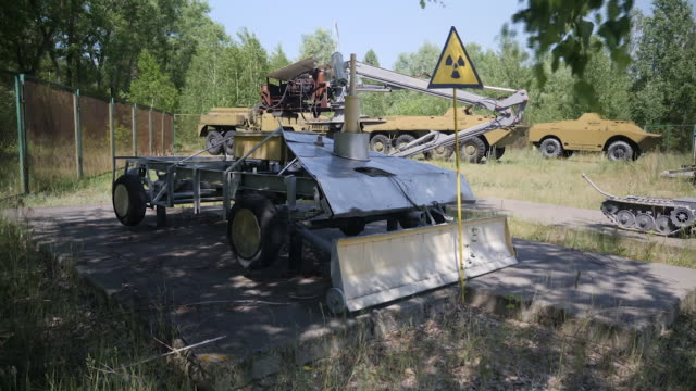 exterior shots of various robotic vehicles said to have been used in the chernobyl disaster clean up including what appears to be a mars rover, and a... - radiation stock videos & royalty-free footage