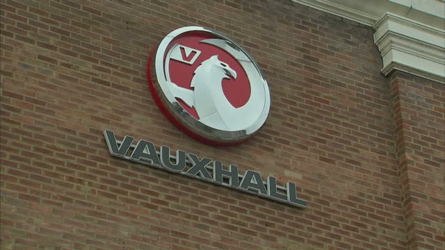 exterior shots of vauxhall car dealership showroom including vauxhall badges logos on side of building and vauxhall factory building banner on side... - showroom stock videos & royalty-free footage