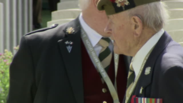 exterior shots of veterans visiting the bayeux war cemetery to commemorate the 75th anniversary of the dday landing on 06 june 2019 in bayeux 2019... - d day stock-videos und b-roll-filmmaterial