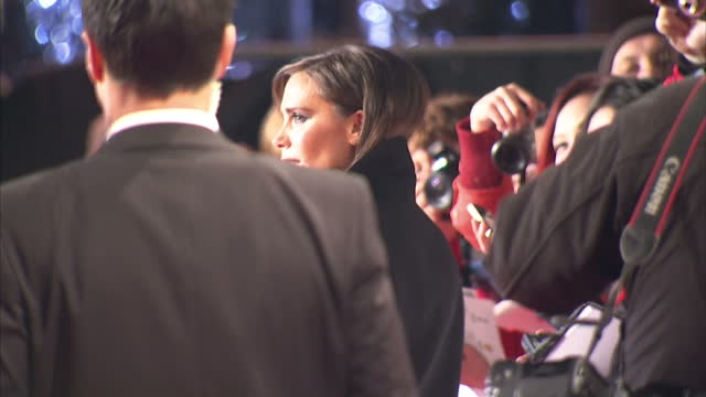 exterior shots of victoria beckham signing autographs and posing for photos on the red carpet at the premiere of the class of '92 london premiere of... - 有名人のサイン点の映像素材/bロール